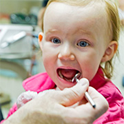 Dentist Performing Preventive Care on a Child